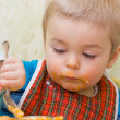 Stock Photo: Cute little boy eating squash