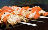 Pieces of meat roasting at skewers, named shashlik — Stock Photo