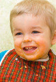 Cute little boy stained with squash — Stock Photo