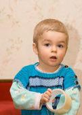 Cute small boy holding sticky tape — Stock Photo