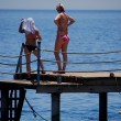 Stock Photo: Women on jetty