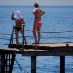 Women on jetty — Stock Photo #15311815