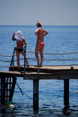 Women on jetty — Stock Photo