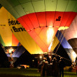 Stock Photo: Colorful balloons fire in night