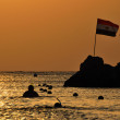 Sea at sunrise and egyptian flag — Stock Photo