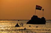 Sea at sunrise and egyptian flag — Stock Photo