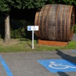Parking for handicapped with barrel — Stock Photo