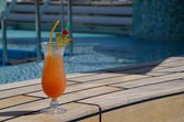 Orange coctail at pool — Stock Photo