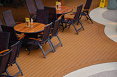 Tables in relaxing area on ship — Stock Photo