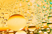 Oil in yellow liquid — Stock Photo