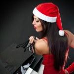 Девушка в костюме Санта-Клауса одежду с корзина — Стоковое фото