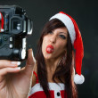 Stock Photo: Funny Santa Claus Woman with Camera