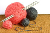 Balls of wool and knitting needles — Stock Photo