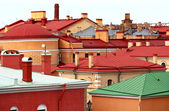 Colored roofs against the background of blue sky. — Stock Photo