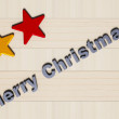 Painted stars, Merry Christmas and wooden board — Stock Photo