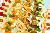 Catering buffet style with different light snack — Stock Photo