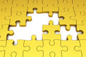 Gold puzzle pieces — Stock Photo