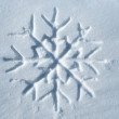 Snowflake written in snow — Stock Photo