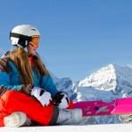 Snowboard, snow, sun and winter fun — Stock Photo #13752814