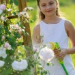 Summer garden, watering - beautiful girl watering roses with ga — Stock Photo #28094563