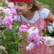 Stock Photo: Rose garden - beautiful girl playing in the rose garden