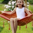 Rest in the garden - lovely girl inl hammock — Stock Photo