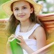 Rest in the garden - lovely girl inl hammock — Stock Photo #28094899