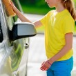 Carwash - young girl in carwash — Stock Photo