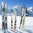 Ski season , mountains and ski equipments on ski run — Stock Photo #31300243