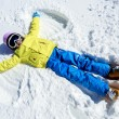 Постер, плакат: Winter fun Snow Angel young skier girl playing in snow