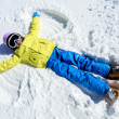 Winter fun - Snow Angel - young skier girl playing in snow — Stock Photo #31301009