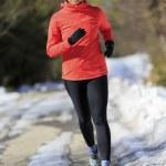 Winter running, exercise woman — Stock Photo