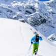 Skiing, Skier, Freeride - Man with skis climbs to the top — Stock Photo #31303319
