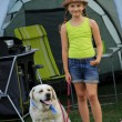 Summer in the tent - young girl playing with dog on the camping — Stock Photo