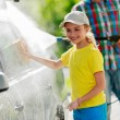Carwash - young girl with father in carwash. — Stock Photo