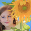 Girl and sunflower - beautiful girl is smelling sunflower in the — Stock Photo