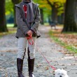 Autumn walk with puppy — Stock Photo