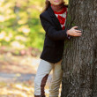 Autumn fashion girl - lovely girl has a fun in autumn park — Stock Photo