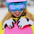 Stock Photo: Winter sports - portrait of young snowboarder girl