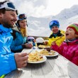 Stock Photo: Winter, ski - skiers enjoying lunch in winter mountains