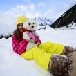 Winter, child, snow - young girl with dog enjoying winter — Stock Photo