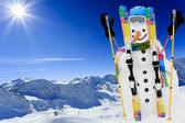 Ski, snowman and winter fun — Stock Photo