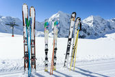 Ski season , mountains and ski equipments on ski run — Stock Photo