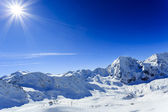 Winter mountains, ski run in Italian Alps — Stock Photo
