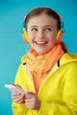 Young girl enjoying music — Stock Photo