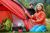 Camp in the tent - family setting a tent on the camping — Stock Photo