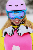 Winter sports - portrait of young snowboarder girl — Stock Photo