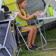 Summer camp - young girl playing in the tent — Stock Photo