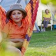 Summer in the tent - young girl with family on the camping — Stock Photo #31334891