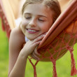 Rest in the garden - lovely girl in hammock — Stock Photo
